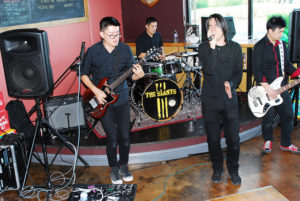 "Photo credit: ""The Slants"" performing at a 1st Amendment Society concert, by Grundick, via Flickr"